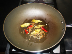 Add red chilies and curry leaves and fry