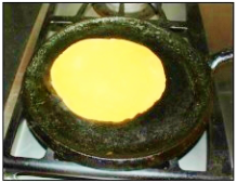 Place the roti on hot griddle