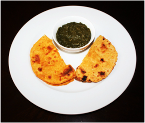 Serve makai ki roti with sarson ka saag