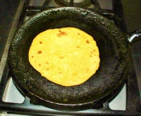 Turn the roti to other side